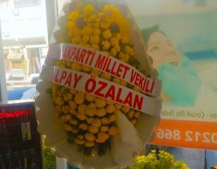 A bouquet of flowers was presented as a gift by Izmir's Deputy Albay Uzelen